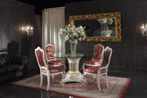 luxury chairs and small table with flowers on it