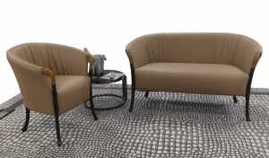 comfortable brown chair and double chair with small round table in between