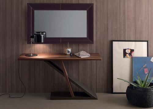 wooden desk by a wooden wall
